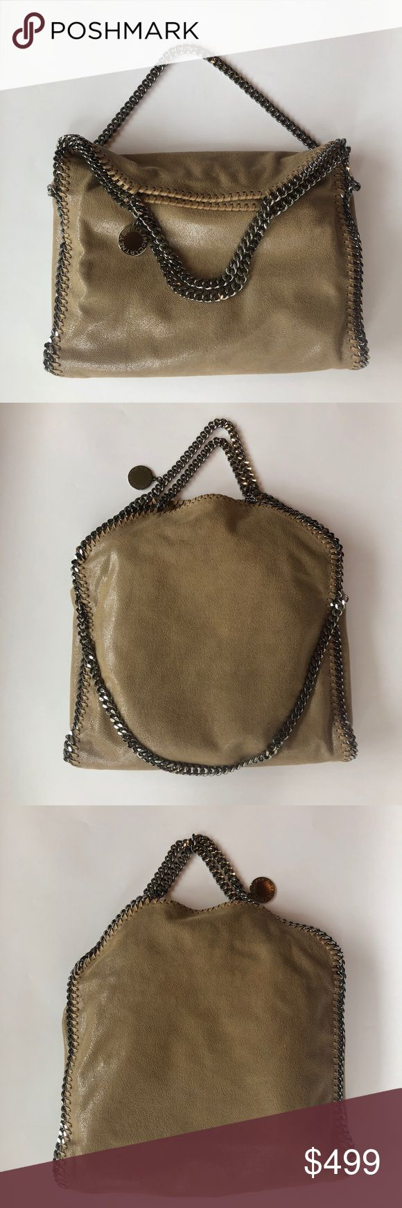 """Stella McCartney Medium Falabella Tan foldover bag Perfect condition, has sat unused in my closet since purchasing from Neiman Marcus in 2016. The fabric is """"Shaggy Deer"""" in a versatile taupe/tan color.   Comes with Stella McCartney dust bag and I still have the tag covering too. The inside has one zipper pocket and is lined with logo fabric. Please let me know if you have questions!   Dimensions:  14""""H x 14.5""""W x 3.5""""D Stella McCartney Bags Totes"""