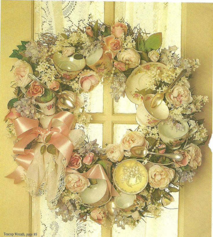 I saw this wreath in a Flea Market Finds book. They took an old wreathe and attached old mismatched tea cups, saucers and added flowers, gre...