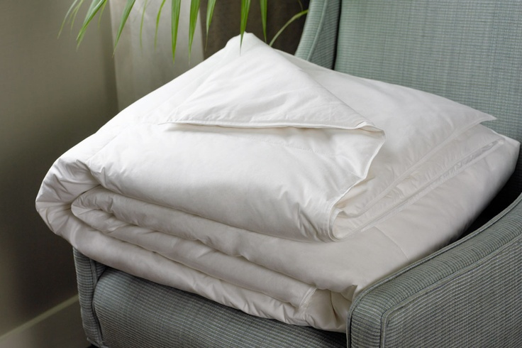 "Heavenly Down Blanket.  The ultimate blanket for all seasons. Filled with European premium white down. An anti-microbial treatment keeps it fresh, clean and comfortable after repeated washes. 12"" square baffle boxes prevent shifting."
