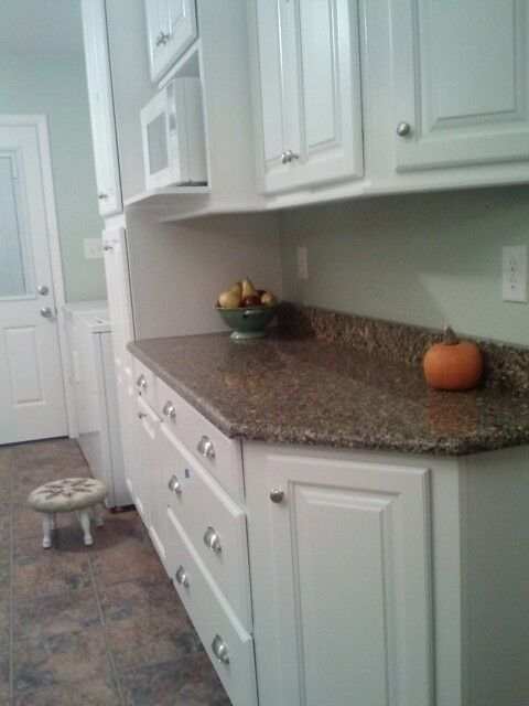 lowes kitchen reno white shenandoah grove cabinets and silestone black canyon countertop kitchen