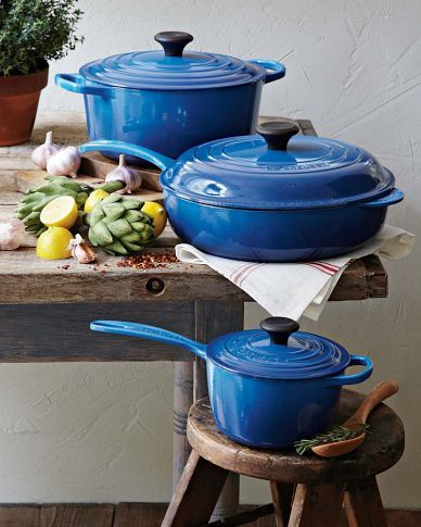 Le Creuset in Azure Blue  I adore these and would love to have them in my kitchen some day but for now I'm working on getting then for my mom!!