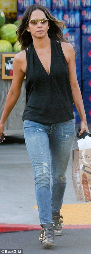 Forever young: Makeup free Halle Berry, 50, looks half her age #dailymail