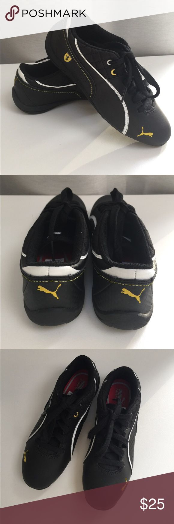 Kids Puma Ferrari Sneaker This is the Ferrari edition driving shoe by Puma. This black shoe with yellow and white accents was barely worn once (it was an impulse buy by husband and was too small for my son 😆). Sorry no box.  Non smoking home and please no🚫trades. Puma Shoes Sneakers