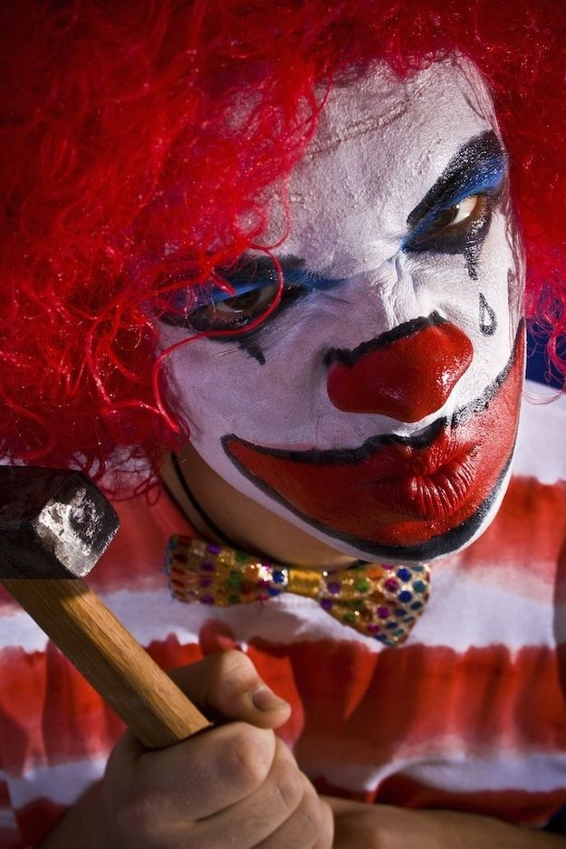 The deranged circus clown. | 15 Types Of Stock Photo Clowns That Will Haunt Your Dreams