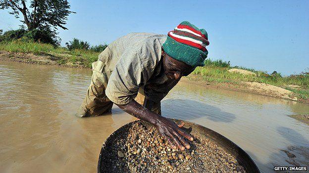 Man panning for diamonds in Sierra Leone