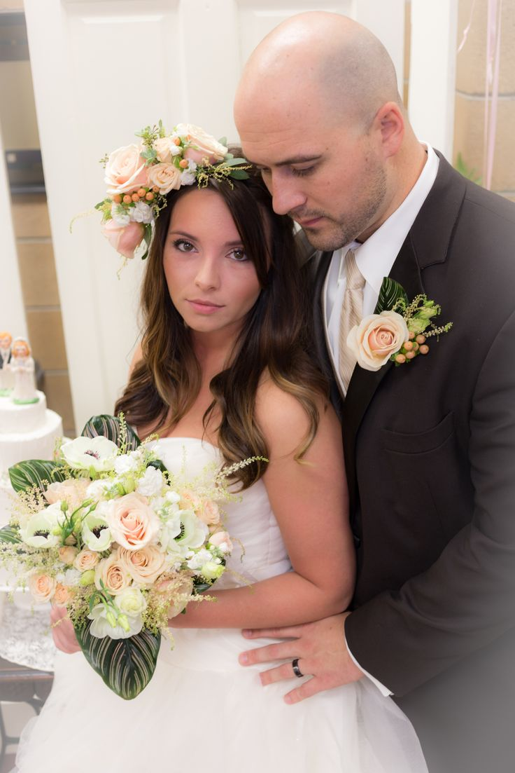 Bridal floral crown with coordinating bouquet in peaches and creams with roses, spray roses, stock, astilbe, anemones and lisianthus. Chocolate tuxedo rental from Wooster Floral.