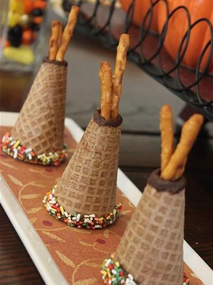 14 Thanksgiving Treats Almost Too Adorable to Eat | TEE PEES | Food crafting just got more fun with these easy-to-make tee pees. Grab pretzel sticks, sprinkles, sugar cones and melted chocolate and you're good to go!