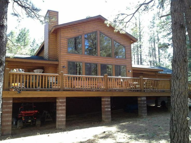 MLS 69156: PRICE REDUCED - This custom built 2 bd, 2 bath log sided cabin features: split flr plan,22'x 14'loft,open kitchen w/alderwood cabinets, side by side refrigerator, smooth cook top stove, dishwasher, microwave looking into the great room, engineered up graded hardwood floors, bath 1 features copper counter top w/copper bowl sink, bath 2 has copper counter top w/stone sink, back trex deck,8x10 tree house, this home is a must see in Mesa Verde next to forest lakes.