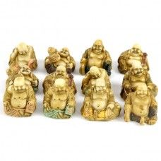 Each Buddha is made from resin, and finished in light pastel tones.