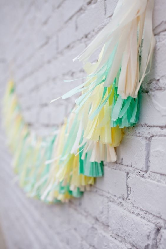mint and yellow tassle bunting / http://www.himisspuff.com/mint-and-yellow-wedding-ideas/7/