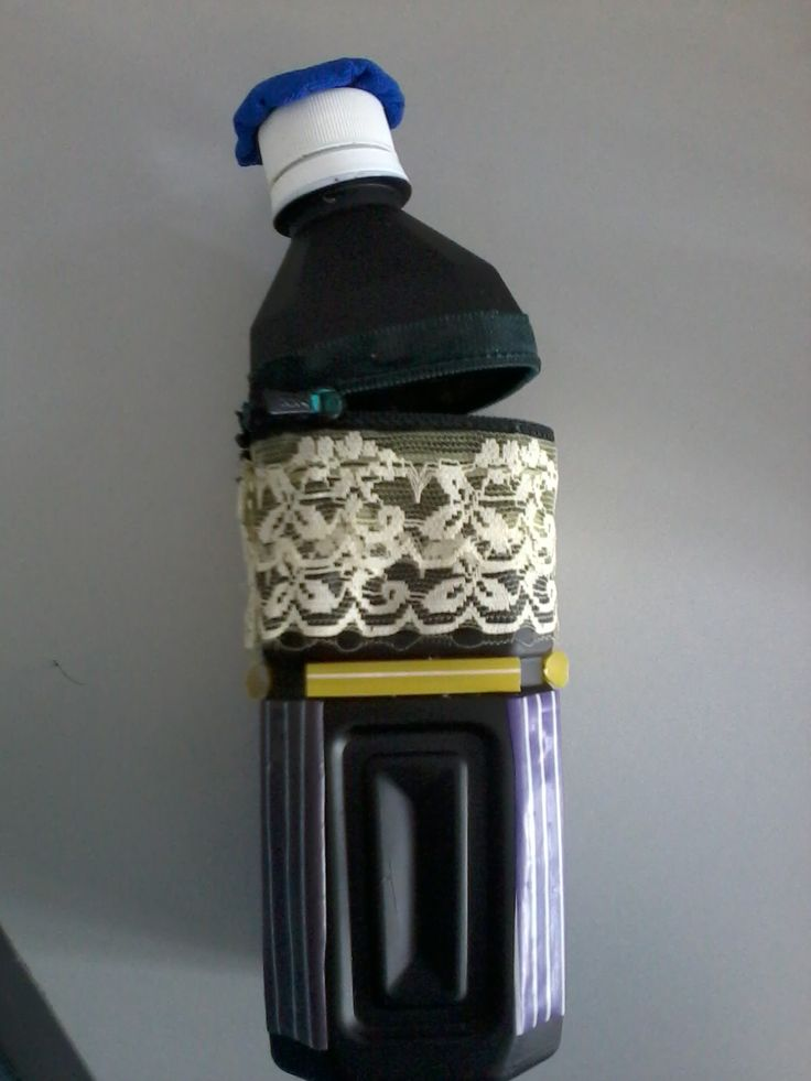 Naufal's pencil case. It's made of bottle, straw, lace, paint brush, zipper and a piece of cloth