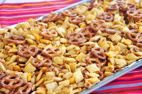 My mix is based on a recipe that my childhood best friends mother, Mrs. Harper, had for Chex Mix. It became an annual ritual for me to call her to ask for the recipe yet again. :) This mix is so very, very yummy and decadent! Good thing I only make it once a year...