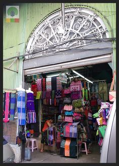 Best Shopping in Yangon: Bogyoke Market. One of the most popular items for sale at the market are the traditional 'longyi' skirt worn by women.