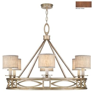 Executed by skilled metal artisans, this antique bronze chandelier is inspired by the 1920`s unique transitional period in architecture & design in Cienfuegos. Also available in soft gold or weathered greige patina. Includes textured natural greige fabric shades.
