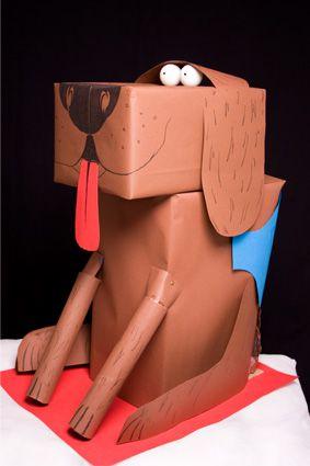 Een mooie surprise maak je met een paar dozen en papier. Hier een hond.