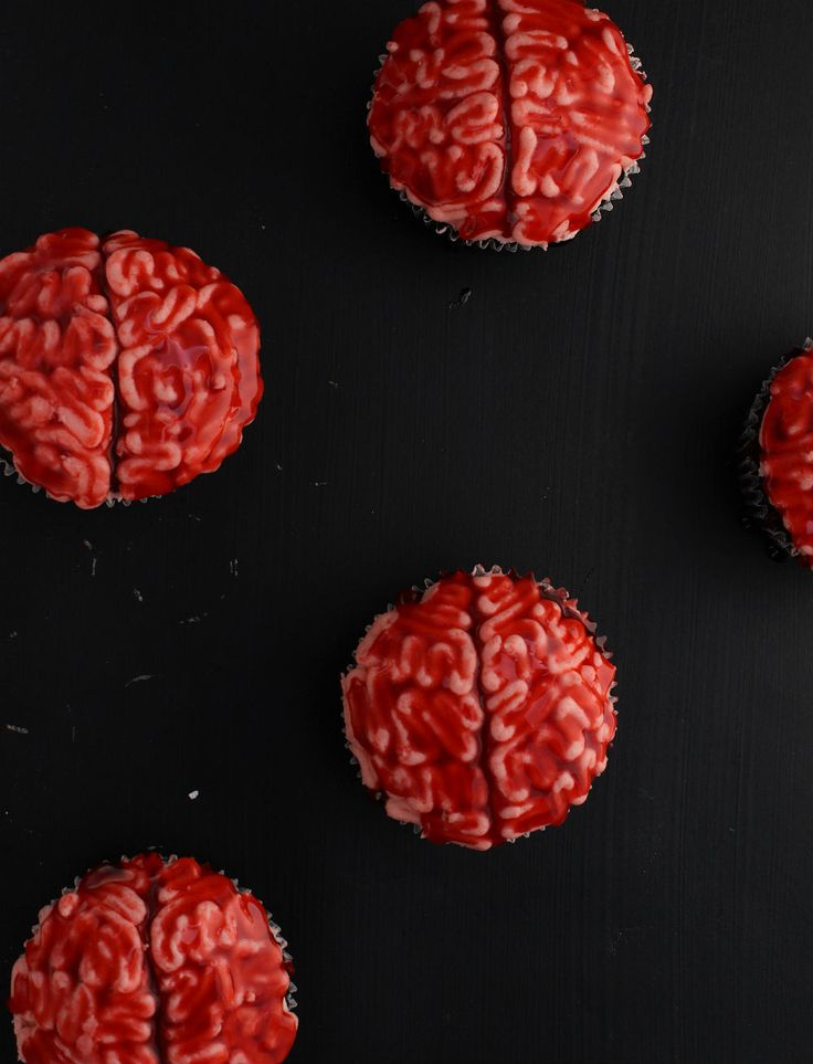 Get your gross on with this easy tutorial for bloody brain cupcakes! Perfect for your Halloween party! | The Simple, Sweet Life