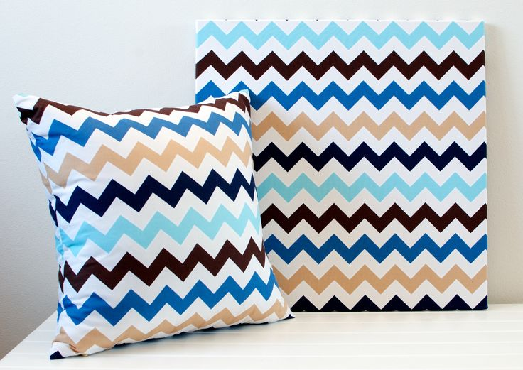 Blue and Beige Chevron Cushion 45cm x 45cm  Add some colour and fun to your room with this unique bold chevron cushion. Combined with the matching wall art and co-ordinating cushions, the colours and patterns bring the sea, sand and surf into your home. The fabric is high quality 100% Cotton, with the pattern featured on both sides of the cushion.  Find the two pieces here: www.laurenunlimited.com.au