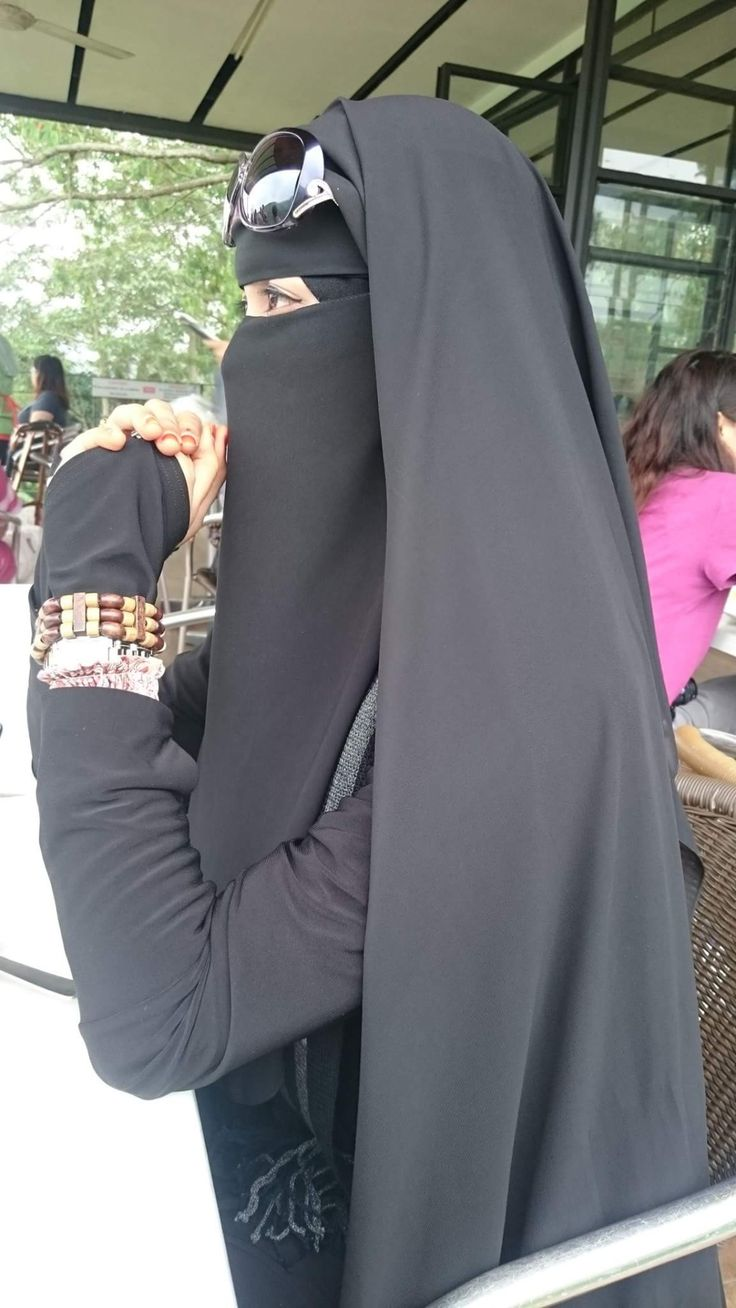 Niqabi in Black Abaya with Sunglasses                                                                                                                                                     More