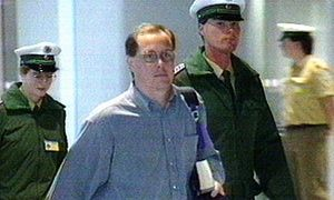Fugitive Nick Leeson is escorted upon arrival at Frankfurt airport, 2 March 1995.