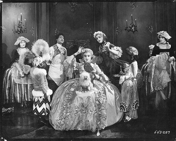 Monsieur Beaucaire, 1924 Lois Wilson is the Queen of France, circled by attendants and accompanied by her lapdog in this typically lavish still from Paramount's Monsieur Beaucaire.
