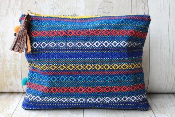 Royal blue pompom embellished clutch bag