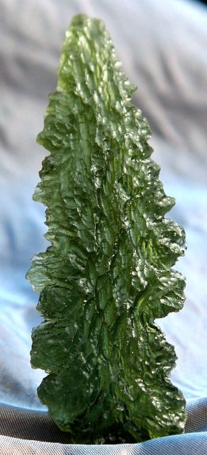 Large Gem Moldavite, a complete piece of meteoric glass found in the Czech Republic. This occured when a huge meteor hit Earth thousands of years ago and the alien rock fused with Earth rock at terrific temperatures, creating these Moldavite Tektites.