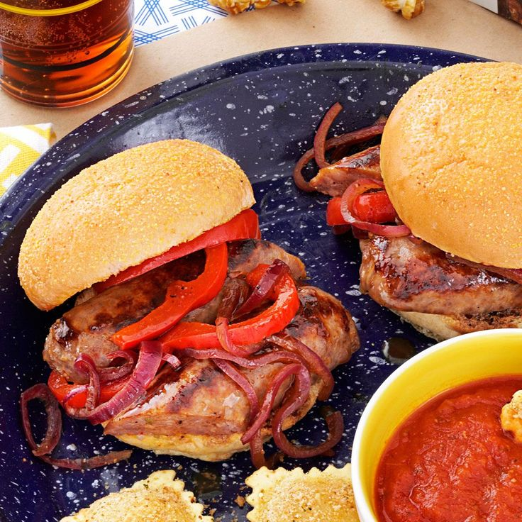 All-American Sausage and Pepper Sliders Recipe -In the ballpark keep one hand free for a fly ball. Learn from this and make sausage and pepper hero sandwiches into sliders. —Veronica Callaghan, Glastonbury, Connecticut