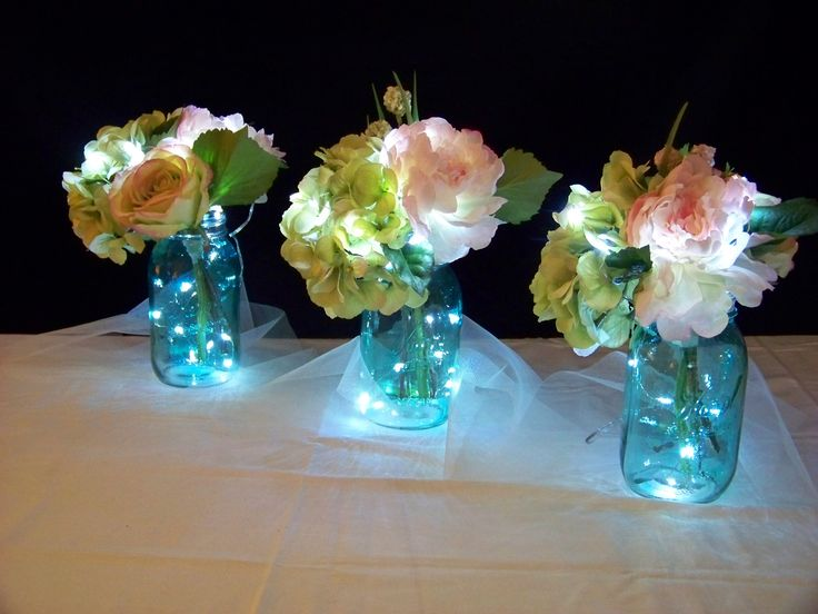 Fairy lighted table centerpieces. I made 16 of these for an outdoor wedding walkway.