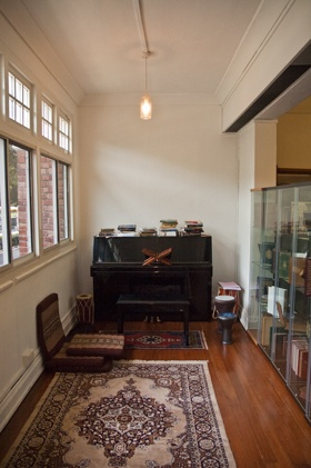 GOHD Books at 142 Bukit Timah Road in 2012 - piano, drums, carpets, cushions, light, and rare books