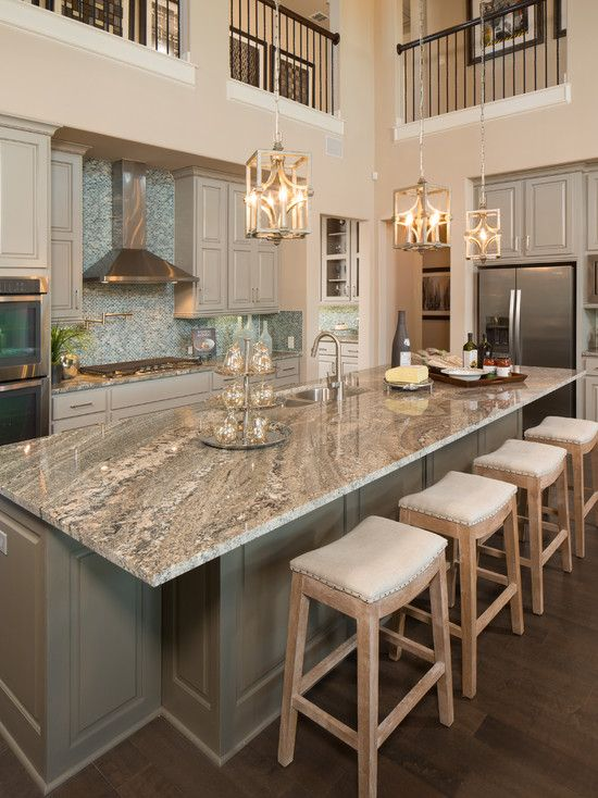 Gorgeous two story kitchen, granite countertops, pendant lighting, blue mosaic backsplash tile, grey cabinetry, extra large island | Five Star Interiors