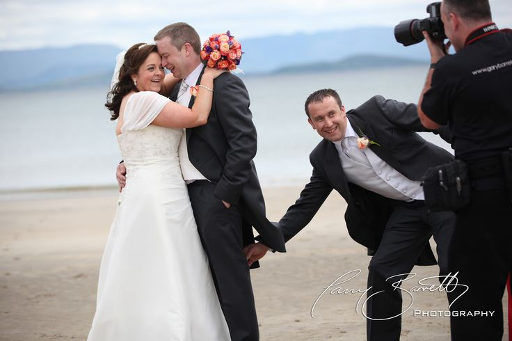 The best man making sure the Groom is smiling, on Mulranny beach, Co.Mayo