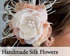 Handmade silk flower and feather hair piece or brooch