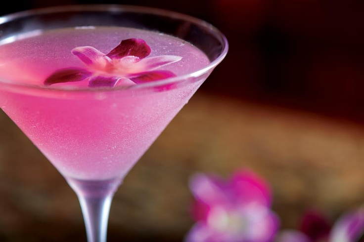 Bonefish Grill Hawaiian Martini - 1/2 oz pineapple juice, 1/2 oz lime, 2 pumps Monin desert pear, 1 pump Monin coconut, 1 oz coconut water, 1 1/2 oz of Cruzan guava rum, garnished with edible orchid
