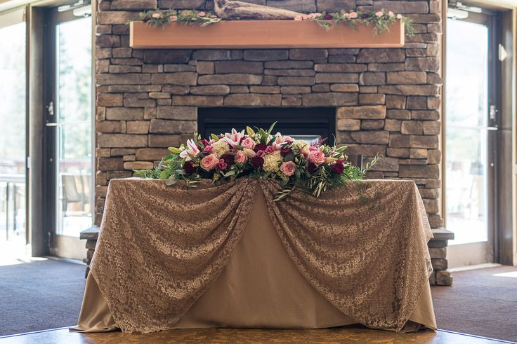 Sweet heart table with marsala, pink and ivory roses and foliage at the Canmore Golf & Curling Club.  Flowers by Janie- Calgary & Canmore Wedding Flowers  www.flowersbyjanie.com  Photo: @oneedition