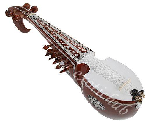 """RABAB: El rubab o robab (en grafía persa, رباب, trl. robāb) es un instrumento de cuerda similar al laúd, originario de Afganistán.1 Su nombre deriva del árabe rebab que significa """"tocado con un arco"""", sin embargo, a diferencia de este instrumento de Asia central, sus cuerdas son pulsadas y su construcción es distinta."""