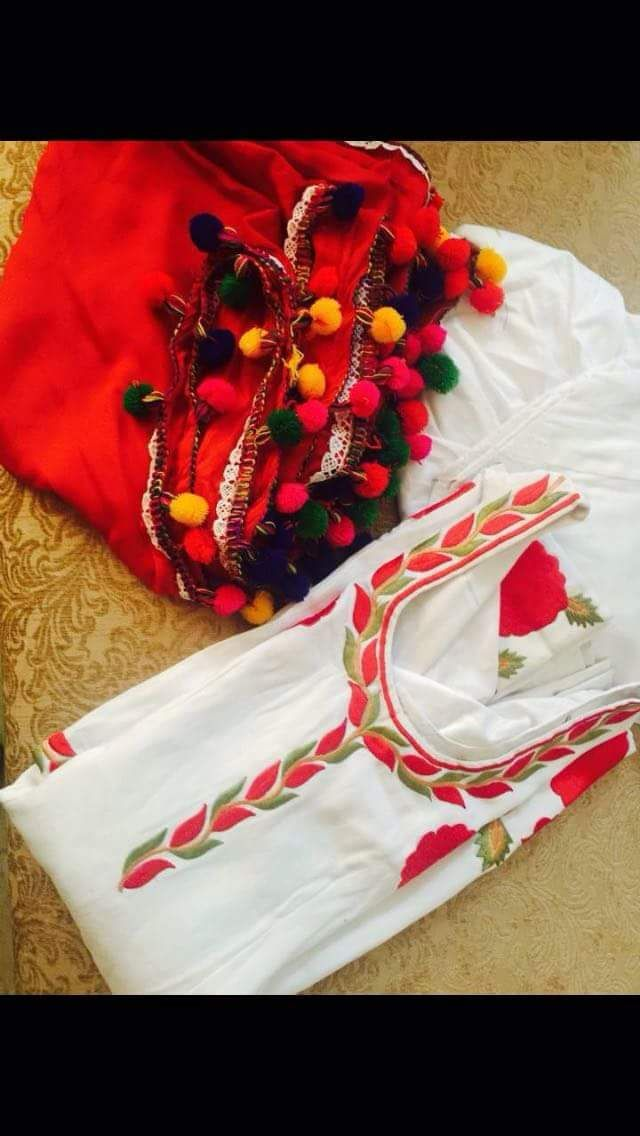Attractive white and red colored machine embroidered suit in cotton with thread embroidery work.