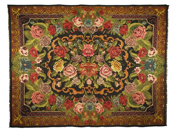 Old Moldovan Kilim (c. 1930 Moldova) - striking floral design with bold colours of red, gold, greens and yellows on black background. Pars Rug Gallery at The Edenbridge Galleries, Edenbridge, Kent.
