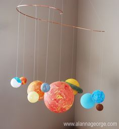 DIY Solar System Mobile - cute hanging in bedroom.  Styrofoam planets every few threads on a felt-cut outs on strings curtain!