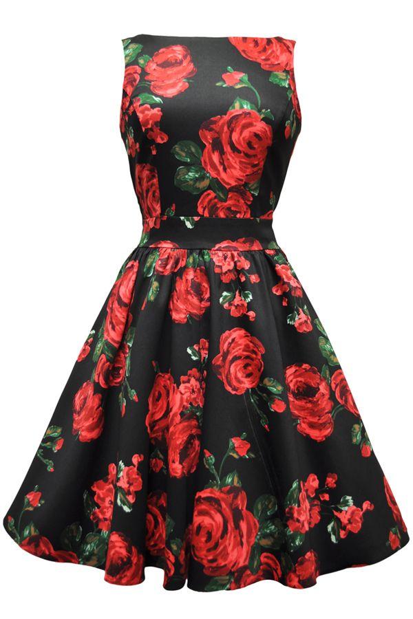 Šaty Lady V London Red and Green Rose Tea Šaty ve stylu 50. let. Nádherné šaty s výrazným vzorem rudých růží na černém podkladě z Vás udělají dokonalou dámu ať už na společenské události, na svatbě či při běžném nošení. Příjemný pružný materiál (97% bavlna, 3% elastan), pohodlný střih s lodičkovým výstřihem, vzadu lehce vykrojené se zapínáním na zip a vázačkou zajistí skvělé přilnutí k Vaší postavě.