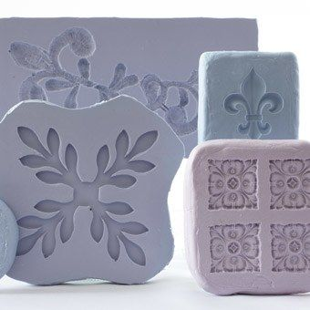 In addition to lace and textured fabrics, Ron can mold decorative ornaments, such as the flor-de-lis, antique buttons and ornate jewels. The molds featured here are an example of the shapes and textures he can work with and create.