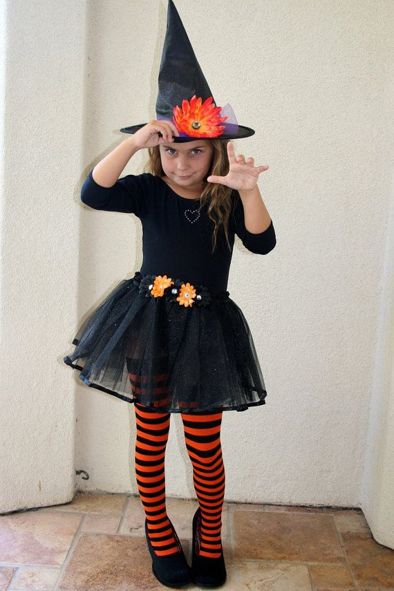 easy diy costume, with purple and black striped tights, can make my own tutu (black, purple and orange).