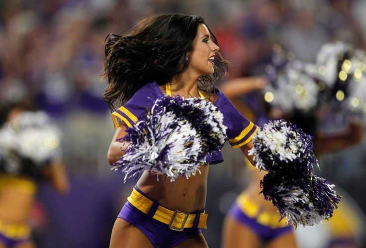 A Minnesota Vikings cheerleader performs during the first half of an NFL…