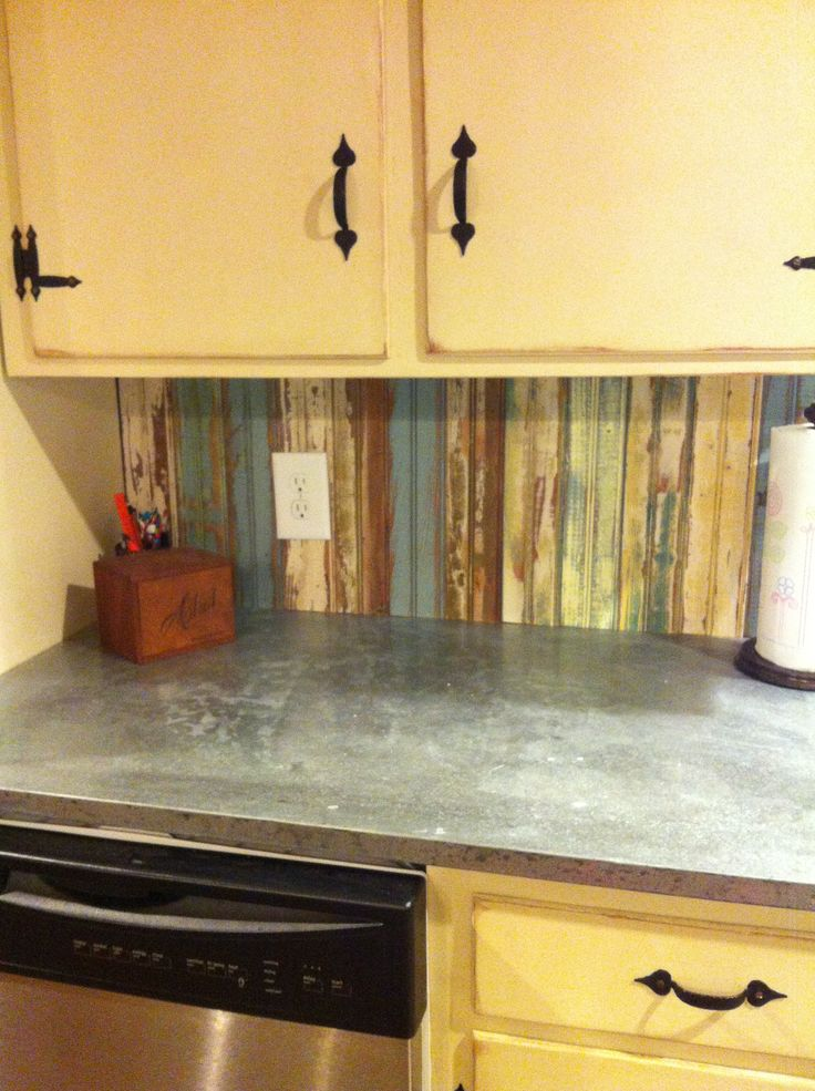 Kitchen countertop sheets instant granite stick on and for Kitchen cabinets lowes with wavy metal wall art