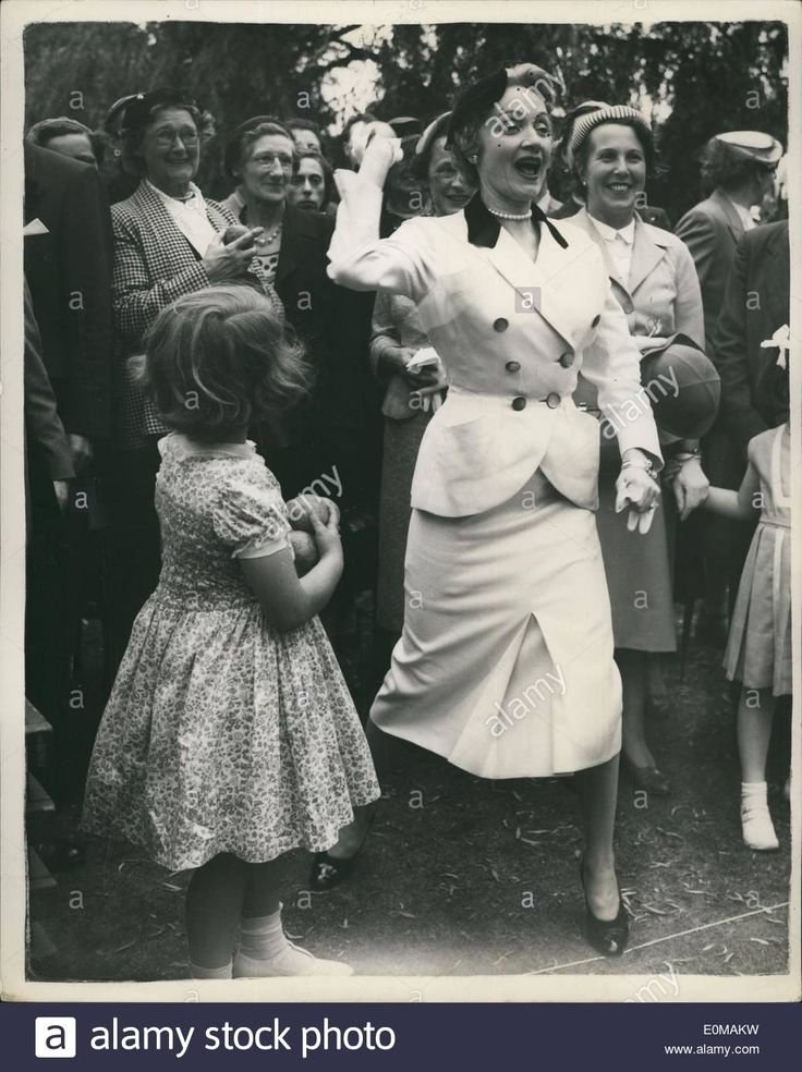 Jul. 07, 1954 - Marlene Dietrich opens garden party,,, she shies a Coconut.... Marlene Dietrich this afternoon performed the cer Stock Photo