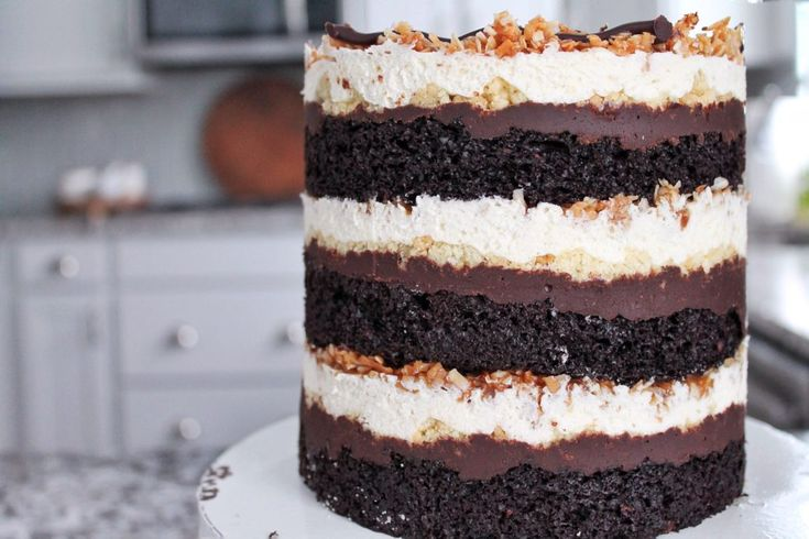 Layers of chocolate cake, chocolate ganache, shortbread cookie crumbs, shortbread cookie frosting, toasted coconut caramel filling.