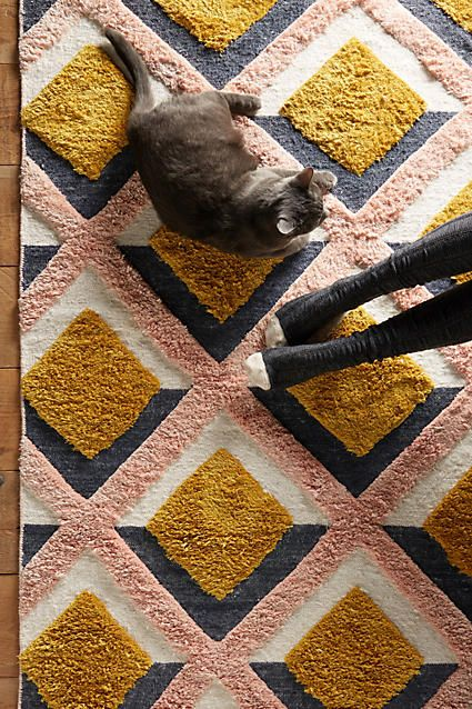 Hand-Tufted Trellis Rug. This tufted trellis motif infuses this versatile rug with modern colour and dimension. A modern yet cosy update to your living space