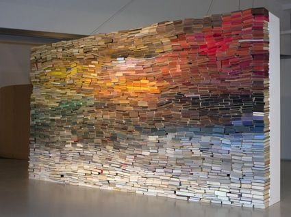 Books worth seeing: Artist Anouk Kruithof stacked dozens of books in her installation, creating a colorscape reminiscent of the sun  on the horizon.