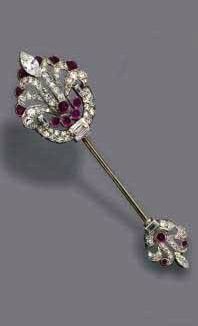 PAIR OF DIAMOND AND RUBY JABOT PIN, CIRCA 1930   The jabot pin en suite, set with single-cut, baguette and marquise-shaped diamonds weighing approximately 1.75 carats, mounted in platinum.