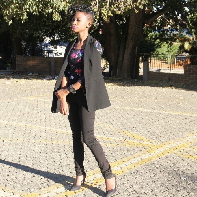 long armless blazer, black denims and colouful bodysuit