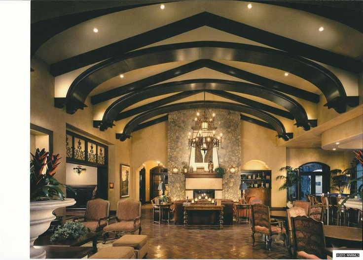 Mediterranean Living Room With Chandelier, Exposed Beam, Stone Fireplace, High  Ceiling, Slate